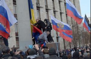 Pro-Russian protestors take down Ukrainian flags in rebel-stronghold Donetsk